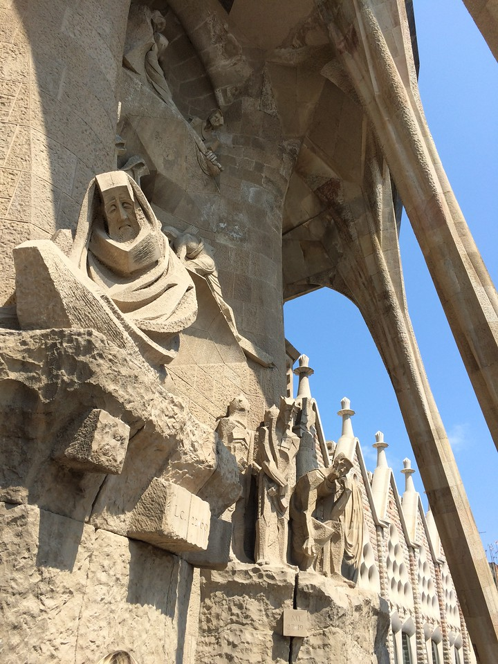The Passion facade of the church is more plain and angular than the Nativity Facade and more somber in theme.