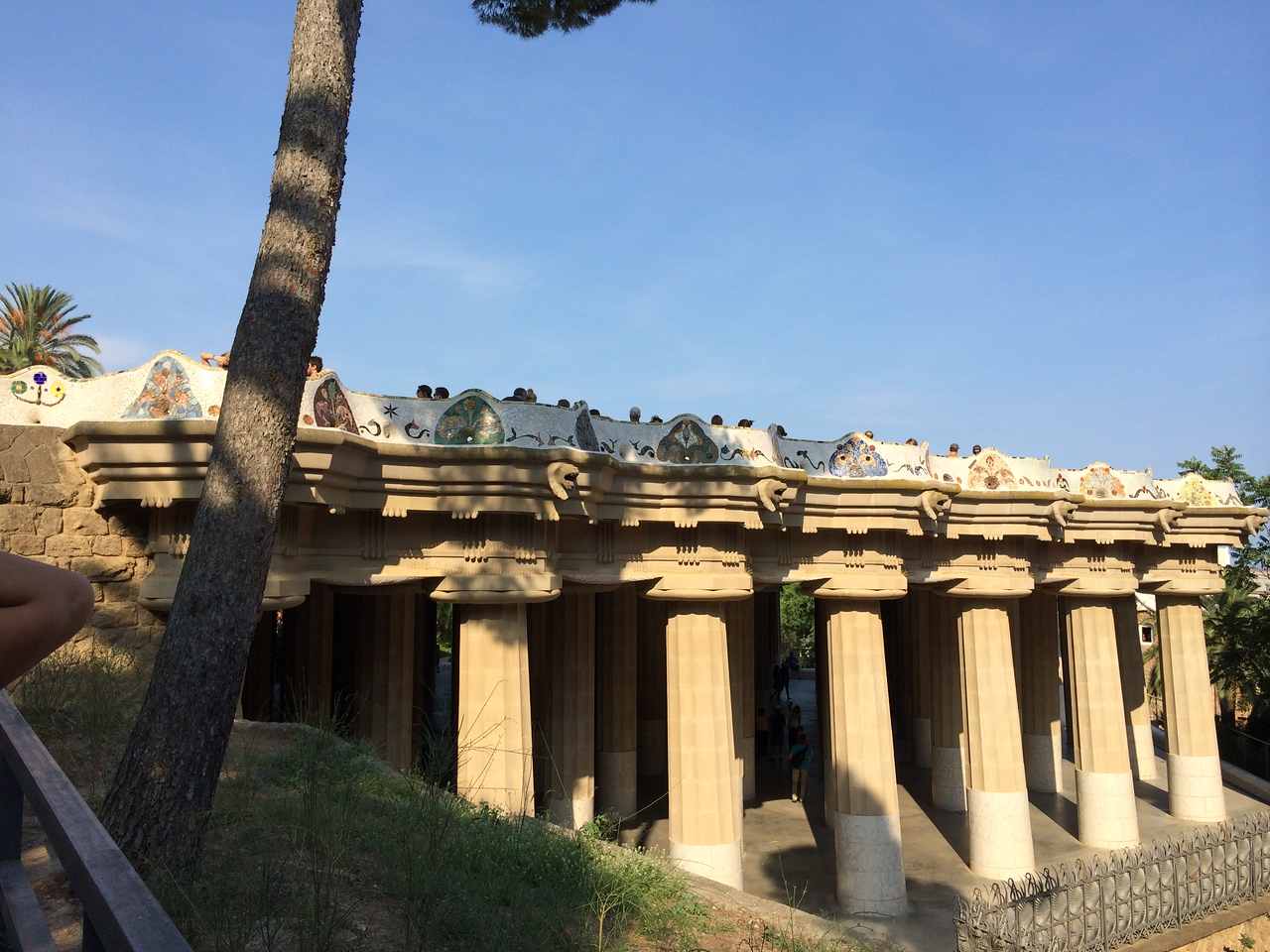 The Doric columns in the marketplace below are hollow and serve as drain pipes for a reservoir to provide water for the fountains on the park grounds. Above the columns is a terrace with undulating tiled mosaic benches which were ergonomically designed.