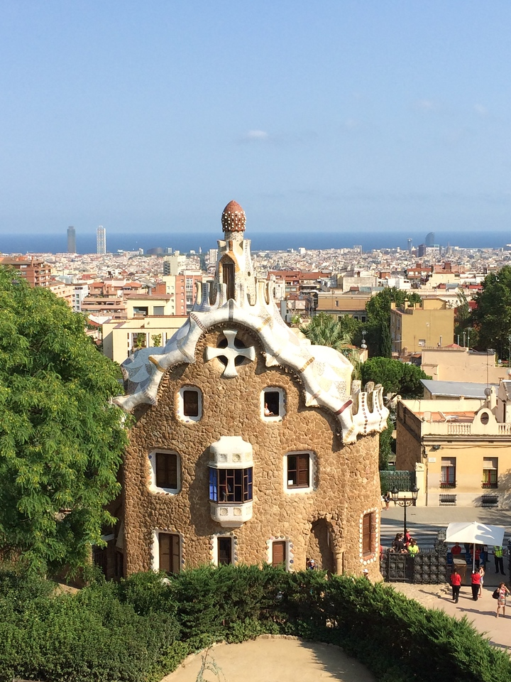 This is the other. The park is very colorful, playful and holds the same undulating natural lines as in many of Gaudi's works. You can't see it, but if you look closely, the white dots on that reddish dome on top of that house are upside down ceramic cups. Yup. He was very quirky.